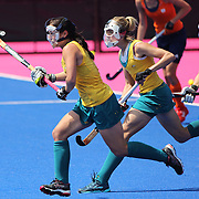 The masked Australian defenders attack a Dutch short corner during the Australia V Holland women's hockey warm up match on the main hockey arena at Olympic Park, Stratford during the London 2012 Olympic games preparation at the London Olympics. London, UK. 22nd July 2012. Photo Tim Clayton