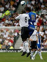 Photo: Steve Bond.<br />Derby County v RCD Espanyol. Pre Season Friendly. 04/08/2007. Darren Moore (L) in an aeriel challange with Albert Riera (R)