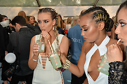 Left to right, PERRIE EDWARDS and LEIGH-ANNE PINNOCK at the Glamour Magazine Women of the Year Awards in association with Next held in the Berkeley Square Gardens, London on 7th June 2016.