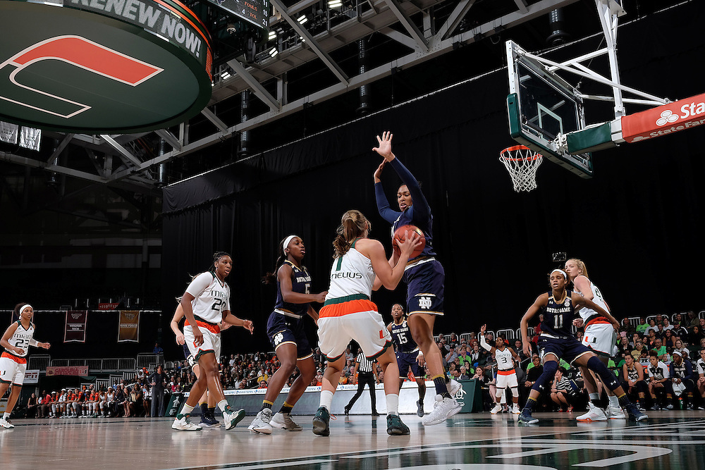 January 8, 2017: Kristina Nelson #21 of Notre Dame tries to block the shot from Laura Cornelius #1 of Miami during the NCAA basketball game between the Miami Hurricanes and the Notre Dame Fighting Irish in Coral Gables, Florida. The 'Irish defeated the 'Canes 67-55.