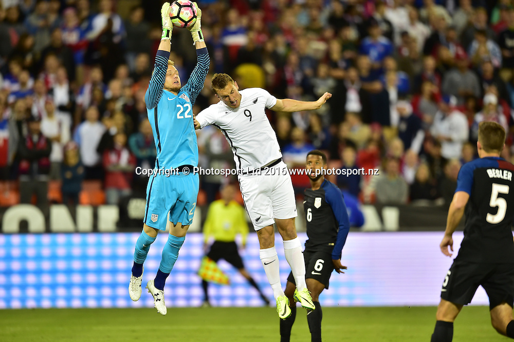USA's William Yarbrough and All Whites Chris Wood in action.<br /> Washington, D.C. - October 11, 2016: The U.S. Men's National team and New Zealand are all even 0-0 in first half play in an international friendly game at RFK Stadium.<br /> Copyright photo: Brad Smith / www.photosport.nz