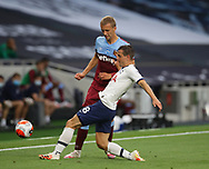 Tottenham's Giovani Lo Celso tussles with West Ham's Tomas Soucek during the Premier League match at the Tottenham Hotspur Stadium, London. Picture date: 23rd June 2020. Picture credit should read: David Klein/Sportimage