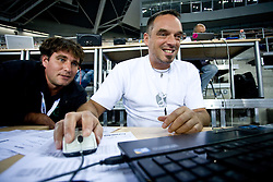 Journalists Ziga Bojc of STA and Gasper Bolhar of Radio Hit before the EuroBasket 2009 Group F match between Slovenia and Turkey, on September 16, 2009 in Arena Lodz, Hala Sportowa, Lodz, Poland.  (Photo by Vid Ponikvar / Sportida)