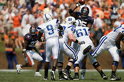 Virginia defensive end Jeffrey Fitzgerald (95) deflects a Duke quarterback Thaddeus Lewis (9) pass.  The Virginia Cavaliers defeated the Duke Blue Devils 23-14 at Scott Stadium in Charlottesville, VA on September 8, 2007  With the loss, Duke extended their longest-in-the-nation losing streak to 22 games.