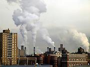 city skyline with smokestacks