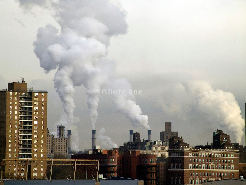 city skyline with smokestacks