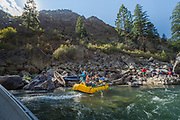 Rope teams are formed to aid the raft team that were pinned agains rocks on their downriver excursion. Even exprienced oarsman run into trouble on the Middle Fork of the Salmon as currents, rapids and rocks change with each passing week.