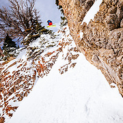 Tigger Knecht drops a cliff band in the Teton backcountry near Jackson Hole Mountain Resort.