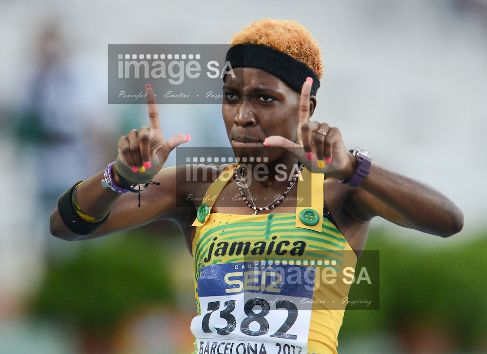 BARCELONA, Spain: Saturday 14 July 2012, Janieve Russell of Jamaica celebrate her win in the women's 400m hurdles during day 5 of the IAAF World Junior Championships at the Estadi Olimpic de Montjuic..Photo by Roger Sedres/ImageSA