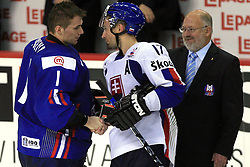 Goalkeeper of Slovenia Andrej Hocevar and Lubomir Visnovsky of Slovakia after ice-hockey game Slovenia vs Slovakia at second game in  Relegation  Round (group G) of IIHF WC 2008 in Halifax, on May 10, 2008 in Metro Center, Halifax, Nova Scotia, Canada. Slovakia won after penalty shots 4:3.  (Photo by Vid Ponikvar / Sportal Images)