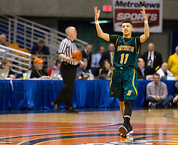 Huntington guard Tavian Dunn-Martin (11) celebrates late in the fourth during the Class AAA championship game at the Charleston Civic Center.