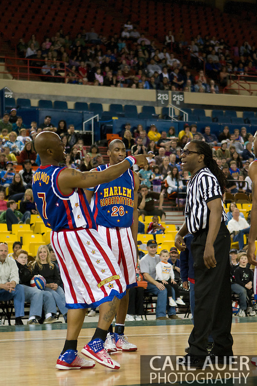 April 30th, 2010 - Anchorage, Alaska:  Moo Moo Evans (7) and Hi-Lite Bruton (26) have fun at the officials expense Friday night at the Sullivan Arena.