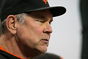 San Francisco Giants manager Bruce Bochy (15) watches his Giants take on the Milwaukee Brewers at AT&T Park in San Francisco, California, on August 21, 2017. (Stan Olszewski/Special to S.F. Examiner)