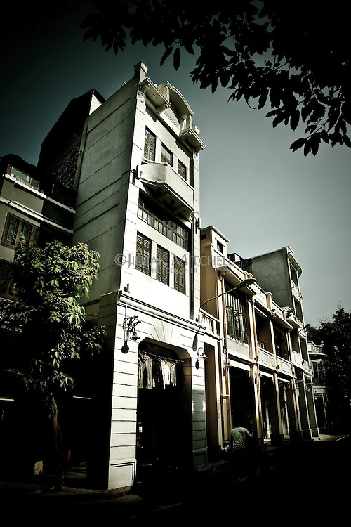 Beautiful old qilou buildings line the peaceful streets of En Ning Street in downtown Guangzhou.