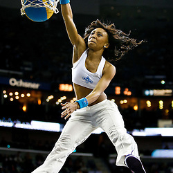 December 3, 2010; New Orleans, LA, USA; A New Orleans Hornets Honeybees dancer dunks a ball during a break in the action of a game against the New York Knicks at the New Orleans Arena. The Knicks defeated the Hornets 100-92. Mandatory Credit: Derick E. Hingle
