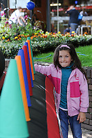 Austeja Januzyte, 7, enjoying the fun being put on for her at the Olympic Torch Relay passes through Hatfield, Herts,