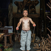 Shopkeeper's workout . Beijing, China
