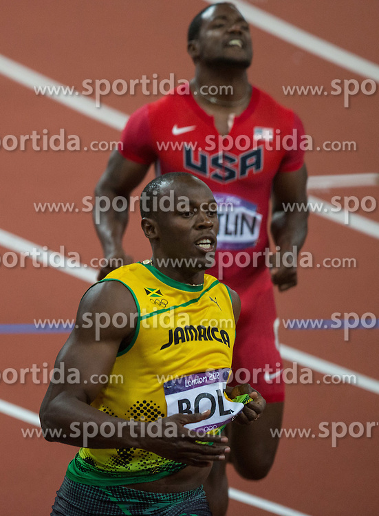 05.08.2012, Olympia Stadion, London, GBR, Olympia 2012, 100m Finale, Herren, im Bild Usain Bolt (JAM; Gold Medaille), Justin Gatlin (USA, Bronze Medaille)  // Gold Medal Usain Bolt (JAM) and bronze medal Justin Gatlin (USA) during Men 100m Final at the 2012 Summer Olympics at Olympic Stadium, London, United Kingdom on 2012/08/05. EXPA Pictures © 2012, PhotoCredit: EXPA/ Johann Groder