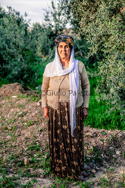 A Yazidi woman wearing the typical ceremony hat