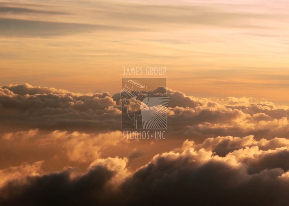 sunrise over high altitude clouds shot from a jet