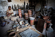 Artisans work by available daylight at a workshop in Lahore. Parts of Pakistan are reportedly suffering 12-20-hours of electricity load shedding (power outages) per day. Many industries are suffering as a result of not being ale to use production machinery during load shedding and are unable meet deadlines for manufacture and delivery of goods.