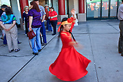 "14 FEBRUARY 2010 - PHOENIX, AZ: A girls spins while warming up before performing at the Chinese New Year celebration in Phoenix, AZ. This marks the Chinese ""Year of the Tiger."" The Chinese New Year Celebration at the COFCO Chinese Cultural Center in Phoenix attracted thousands of people. The celebration featured traditional Chinese entertainment and food.  PHOTO BY JACK KURTZ"