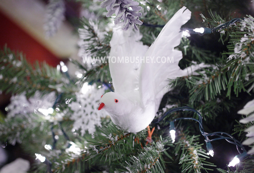 Middletown, New York - A bird and other decorations on a Christmas tree at the Morrison Hall mansion during a Holiday Open House on Dec. 12, 2010. Morrison Hall was the home of the Morrison family, who donated the mansion to Orange County Community College in 1950.