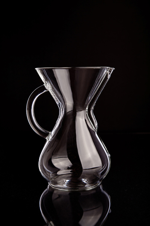 A Chemex glass coffee maker used for brewing coffee. The design of the Chemex coffee maker is part of the permanent collection at the Museum of Modern Art.