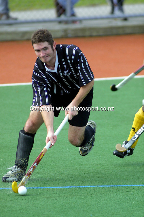 Phillip Burrows in action during the international mens hockey match between New Zealand Black Sticks and Malaysia, 29 April, 2001 at Rosedale South, Albany, Auckland. Photo: Sandra Teddy/PHOTOSPORT<br /><br /><br /><br />philip *** Local Caption ***