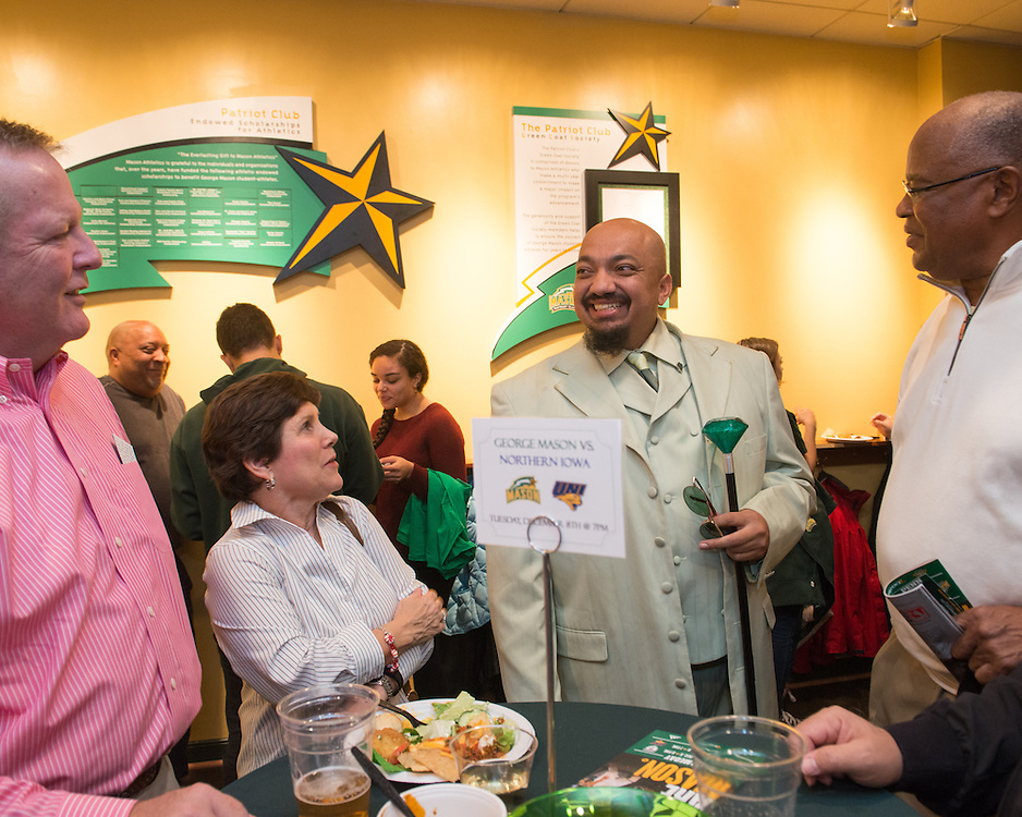 December 5, 2015 - Fairfax, VA - A day in the life of &quot;Doc Nix,&quot; aka Dr. Michael Nickens, the Director of the Athletic Bands for George Mason University. Here Doc Nix mixes with George Mason supporters.<br /> <br /> <br /> Photo by Susana Raab