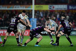 Jacques Vermeulen of Exeter Chiefs is challenged by Fraser Balmain of Gloucester Rugby and Lewis Ludlow of Gloucester Rugby - Mandatory by-line: Ryan Hiscott/JMP - 14/02/2020 - RUGBY - Kingsholm - Gloucester, England - Gloucester Rugby v Exeter Chiefs - Gallagher Premiership