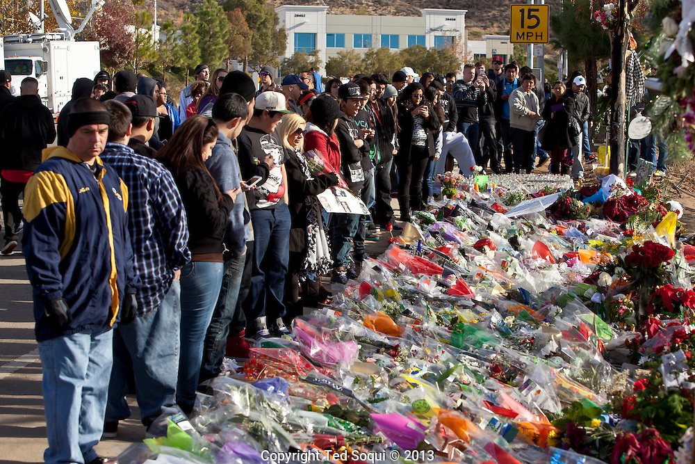 Thousands of flowers and moments left at the crash site.<br /> An informal street memorial for Paul Walker, key actor in the &quot;Fast and Furious&quot; film enterprise, and Roger Rodas, race car driver, who were both killed in a solo car auto accident in Valencia, CA. The memorial was held at the crash site, and featured several cars Paul Walker drove in the &quot;Fast and Furious&quot; films. Thousands of fans and car enthusiast showed up to pay their respects.