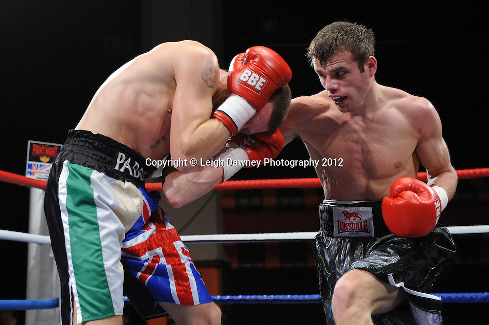 John Waldron (black shorts) defeats Paddy McDonagh in a 10x3 min Light Heavyweight contest at Olympia, Liverpool on the 21st January 2012. Frank Maloney Promotions on Skysports HD1. © Leigh Dawney Photography 2012.