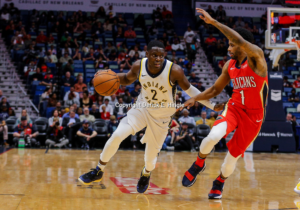 Mar 21, 2018; New Orleans, LA, USA; Indiana Pacers guard Darren Collison (2) drives past New Orleans Pelicans guard Larry Drew II (1) during the second quarter at the Smoothie King Center. Mandatory Credit: Derick E. Hingle-USA TODAY Sports