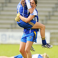 6 August 2012; Clare players Roisin Howley and Niki Kaiser, right, celebrate at the final whistle. Both teams wore provincial colours due to a colour clash, Clare, blue, and Roscommon, white. All-Ireland Ladies Football Minor B Championship Final, Clare v Roscommon, St. Brendan's Park, Birr, Co. Offaly. Picture credit: Pat Murphy / SPORTSFILE *** NO REPRODUCTION FEE ***