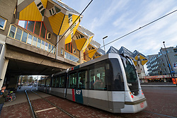 Public tram passes in front of Cube Houses in Rotterdam The Netherlands