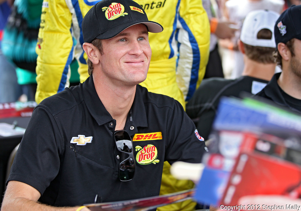Ryan Hunter-Reay signs autographs before the start of the IZOD IndyCar Iowa Corn Indy 250 auto race at the Iowa Speedway in Newton, Iowa on Saturday, June 23, 2012.