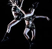 one caucasian young woman modern  dancer dancing isolated on black background with  light painting motion blur speed effect