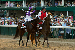 Nyquist with Mario Gutierrez up, left, is congratulated by the crowd after winning the 142nd running of the Kentucky Derby, Wednesday, Aug. 29, 2012 at Churchill Downs in Louisville.