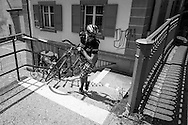 Picture by Andrew Tobin/Tobinators Ltd +44 7710 761829<br /> 04/08/2013<br /> A rider negotiates some steps carrying his bike during the Cycle Messenger World Championships held in Lausanne, Switzerland. Started in 1993 by Achim Beier from Berlin, the championships are not only a sporting contest but an opportunity to unite friends and bicycle enthusiasts worldwide. The event comprises a number of challenges including a sprint, a track stand (longest time stationary on the bike), a cargo race where heavy loads are carried on special bikes, and the main race. The course winds through central Lausanne and includes bridges, stairs, cobbles, narrow alleyways and challenging hills. The main race simulates the job of a bike courier making numerous drops and pickups across the city. Riders need to check in at specific checkpoints, hand over their delivery and get a new one. The main race can take up to 4 hours for each competitor to complete.