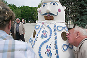 Jug man at City Hall Square...M.S. Johann Strauss, a brand new four star+ river cruiser operated by Austrian River Cruises, and chartered by Club 50 (a travel agency especially for seniors aged 50 and up) undertook an epic 3-week journey (May 21 to June 10, 2004) all the way from Amsterdam to the Black Sea?along Rhine, Main and Danube?, presumably the first passenger vessel ever to have done so. This is one of the images recorded during this historic voyage.