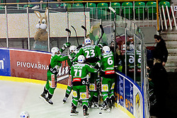 Players of HDD Tilia Olimpija celebrate victory during ice-hockey match between HDD Tilia Olimpija and SAPA Fehervar AV19 at second match in Quarterfinal  of EBEL league, on Februar 21, 2012 at Hala Tivoli, Ljubljana, Slovenia. HDD Tilia Olimpija won 2:1 in OT. (Photo By Matic Klansek Velej / Sportida)