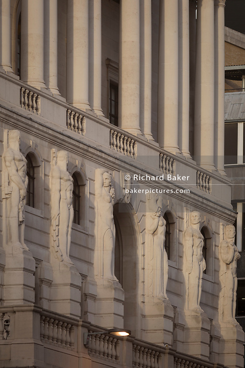 "The Telamon Portland stone figures of the Bank of England on Threadneedle Street in the heart of the Square Mile, the capital's historical and financial centre, on 1st November 2017, in the City of London, England. The Bank of England, is the central bank of the United Kingdom and the model on which most modern central banks have been based. Established in 1694, it is the second oldest central bank in the world. Sir Herbert Baker's rebuilding of the Bank, demolishing most of Sir John Soane's earlier building, was described by architectural historian Nikolaus Pevsner as ""the greatest architectural crime, in the City of London, of the twentieth century""."