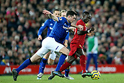 Everton defender Michael Keane (5) leans in on Liverpool forward Sadio Mane (10) during the Premier League match between Liverpool and Everton at Anfield, Liverpool, England on 4 December 2019.