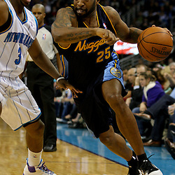 Dec 18, 2009; New Orleans, LA, USA;  Denver Nuggets guard Anthony Carter (25) drives past New Orleans Hornets guard Chris Paul (3) during the second half at the New Orleans Arena. The Hornets defeated the Nuggets 98-92. Mandatory Credit: Derick E. Hingle-US PRESSWIRE