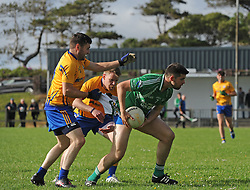 Getting to grips with the opposition..Achill&rsquo;s             tries to away from Knockmore&rsquo;s             during the junior champonship match in Achill on saturday evening.<br /> Pic Conor McKeown