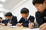The students Ye jun Seo, Na dan Jo and Yul min Sung at the Shinil High School, Seoul, South Korea.