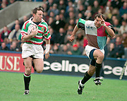 1997 Heineken European Cup,   NEC Harlequins V Leicester Tigers,  The Stoop 18-4-98. Joel Stransky [left] Leicester pursued by Quins' Chris Sheasby, Starnsky went on to score a try [Mandatory Credit, Peter Spurier/ Intersport Images]