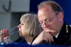 © Licensed to London News Pictures. 22/05/2012. Manchester, UK. The Home Secretary, Theresa May (left) and Sir Hugh Orde, President of the Association of Chief Police Officers (right) at the ACPO conference in Manchester. Photo credit : Joel Goodman/LNP