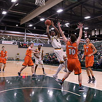 5th year guard Brandon Tull (5) of the Regina Cougars in action during the Men's Basketball Play-In game on February  8 at Centre for Kinesiology, Health and Sport. Credit: Arthur Ward/Arthur Images